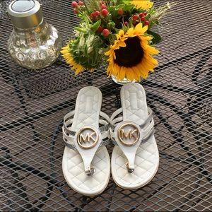 Sz 9 Michael Kors flip flops (they are cream)